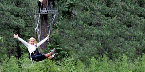 Woman on a zip line tour through southwest Colorado